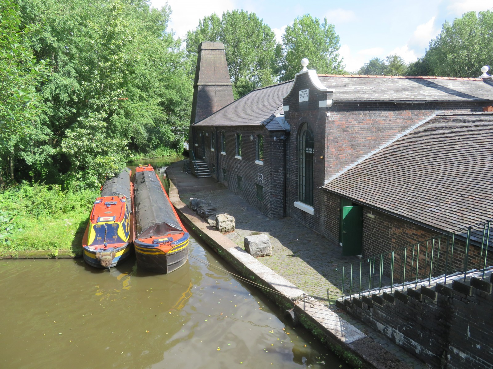 MILL AND WHARF FROM BRIDGE